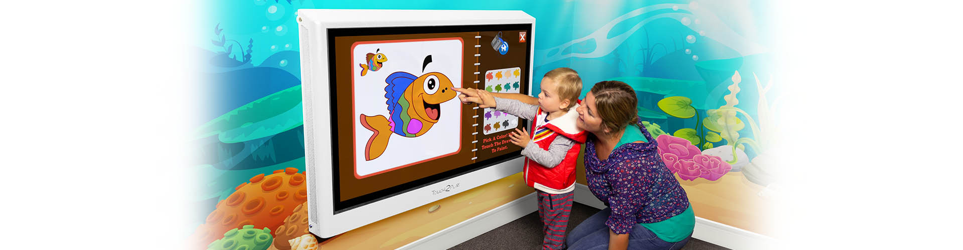"""Kidzpace 50"""" Touch2Play Junior Wall touch screen game cabinet mounted on a wall"""