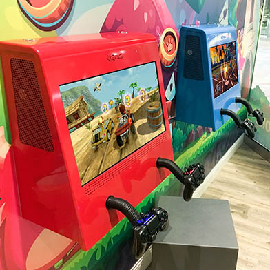 Kidzpace Euro Metal game cabinet with Xbox & PlayStation mounted on a wall in a dental office